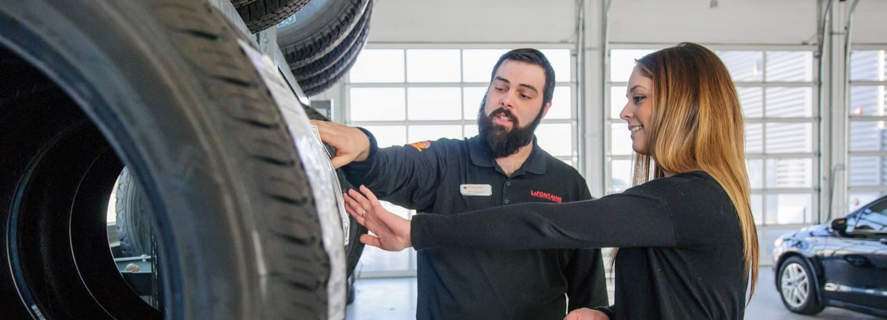 LaFontaine Service Technician looking at Tires