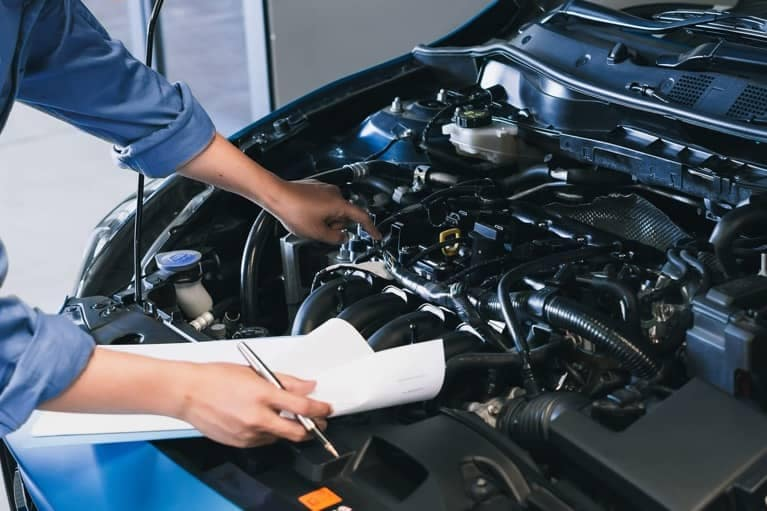 Mechanic Checking Vehicle Engine