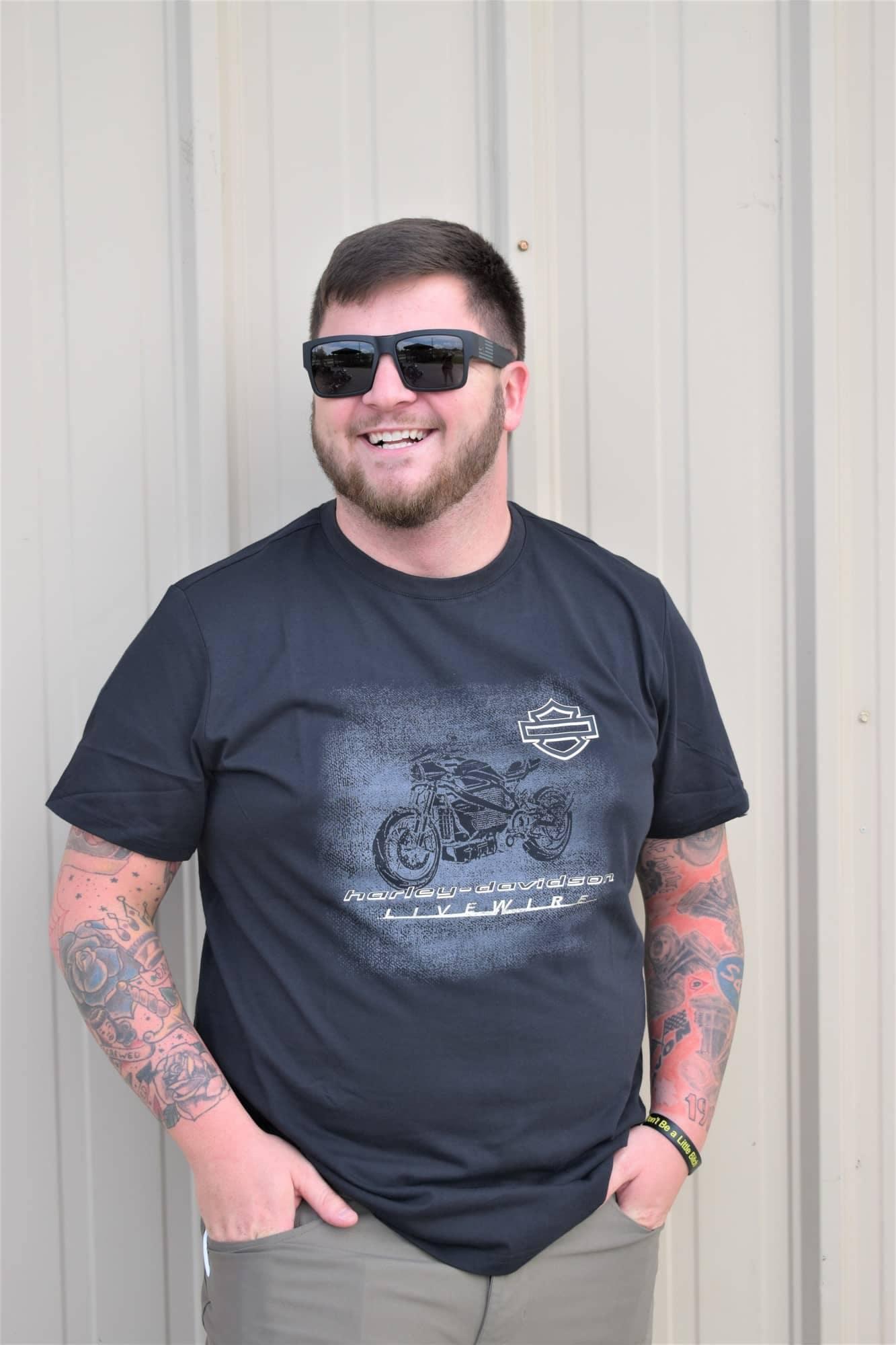 guy wearing black harley-davidson shirt