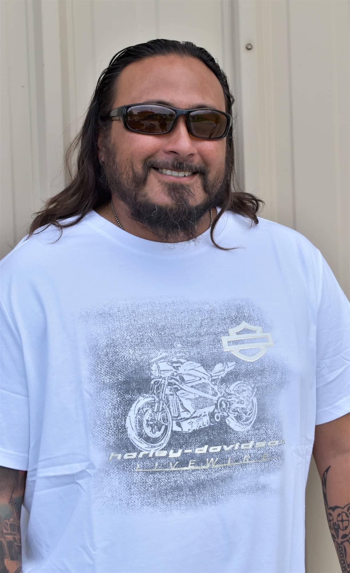 man wearing a white harley davidson shirt