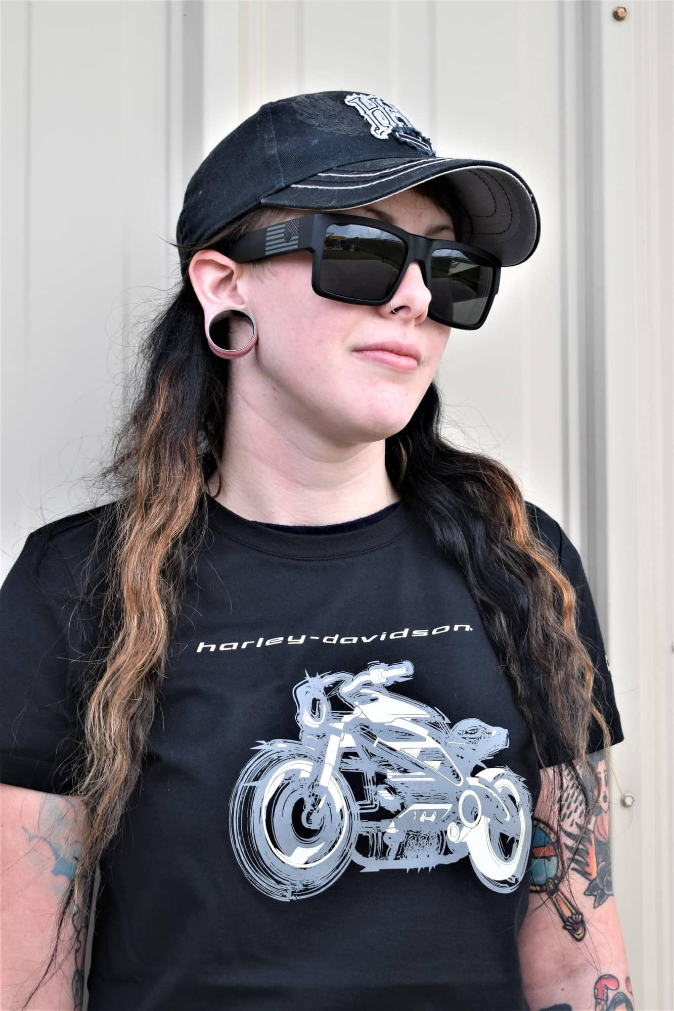 woman wearing a black harley-davidson shirt and hat