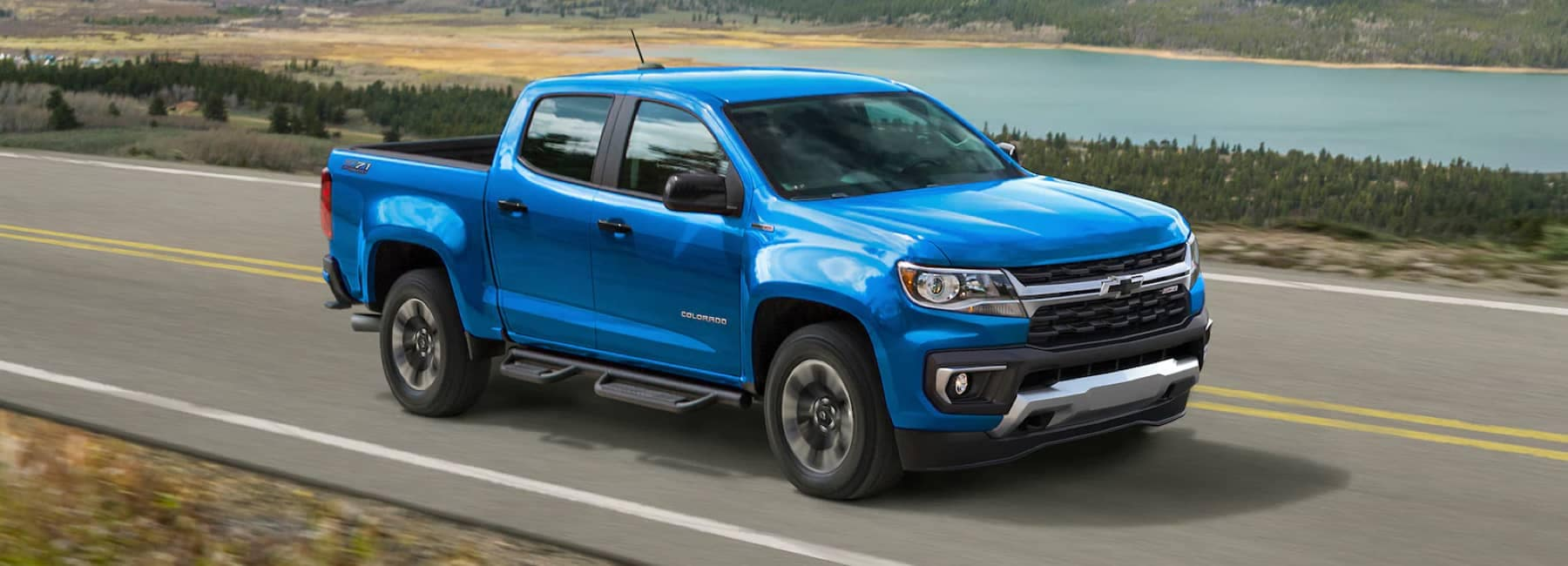 2021 Blue Metallic Chevrolet Colordo Z71 driving on open road