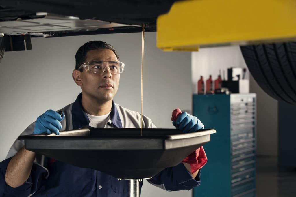 Ford mechanic doing an oil change