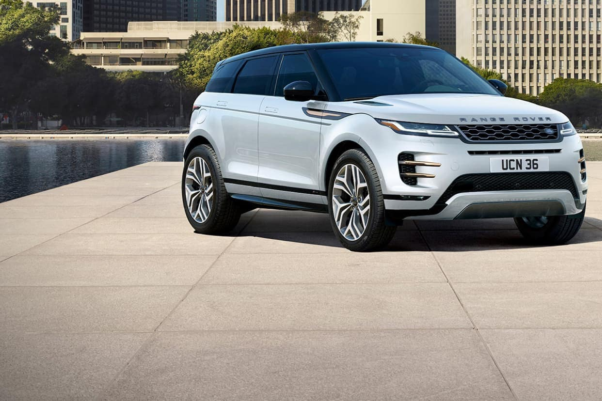 Silver Range Rover on concrete by the water side