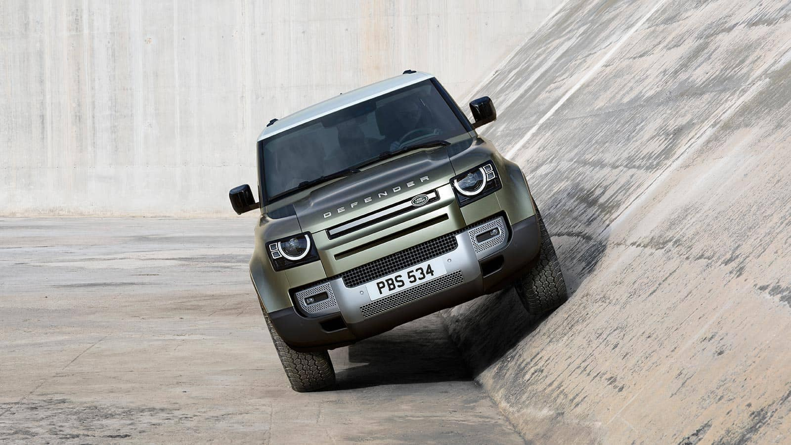 Defender drives on angled concrete wall