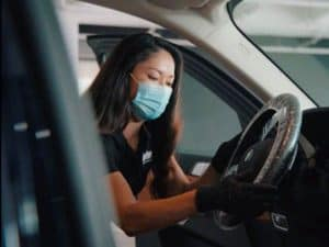 employee-wiping-steering-wheel