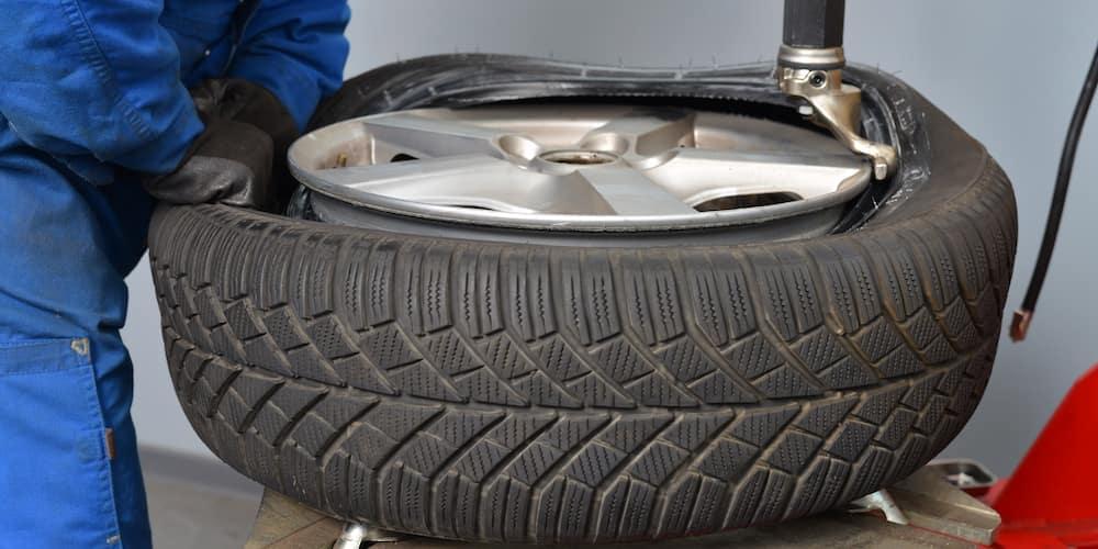 Mechanic Attaching Tire to Rim
