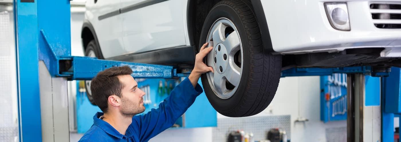 Mechanic Inspecting Tires
