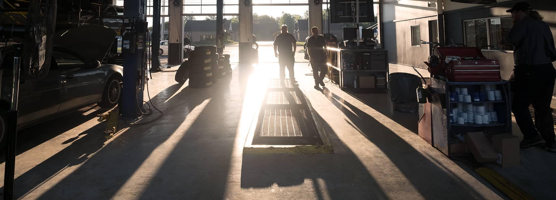 Mechanics at a GM certified collision center start their day with the sun