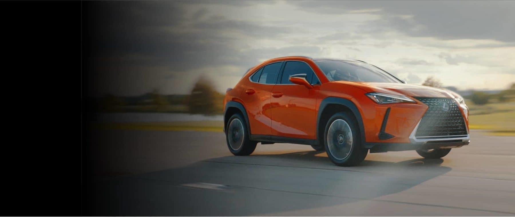 Orange Lexus SUV outside in dust