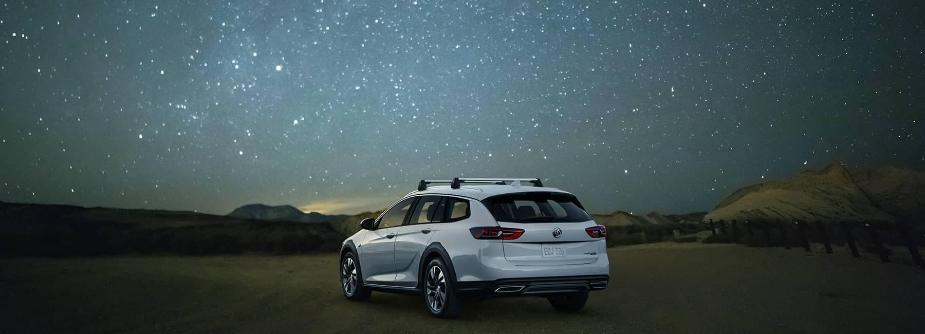 White 2020 Buick Regal TourX under a starry sky