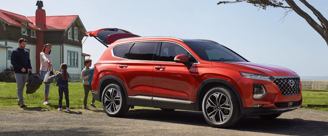 2020 Hyundai Santa Fe with family storing bicycles in trunk