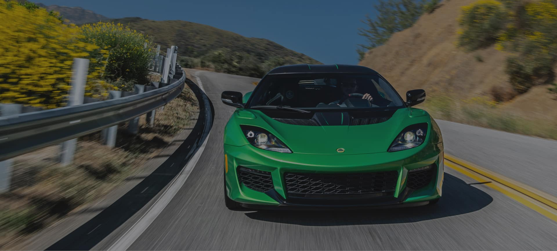Green Lotus Driving Down Highway