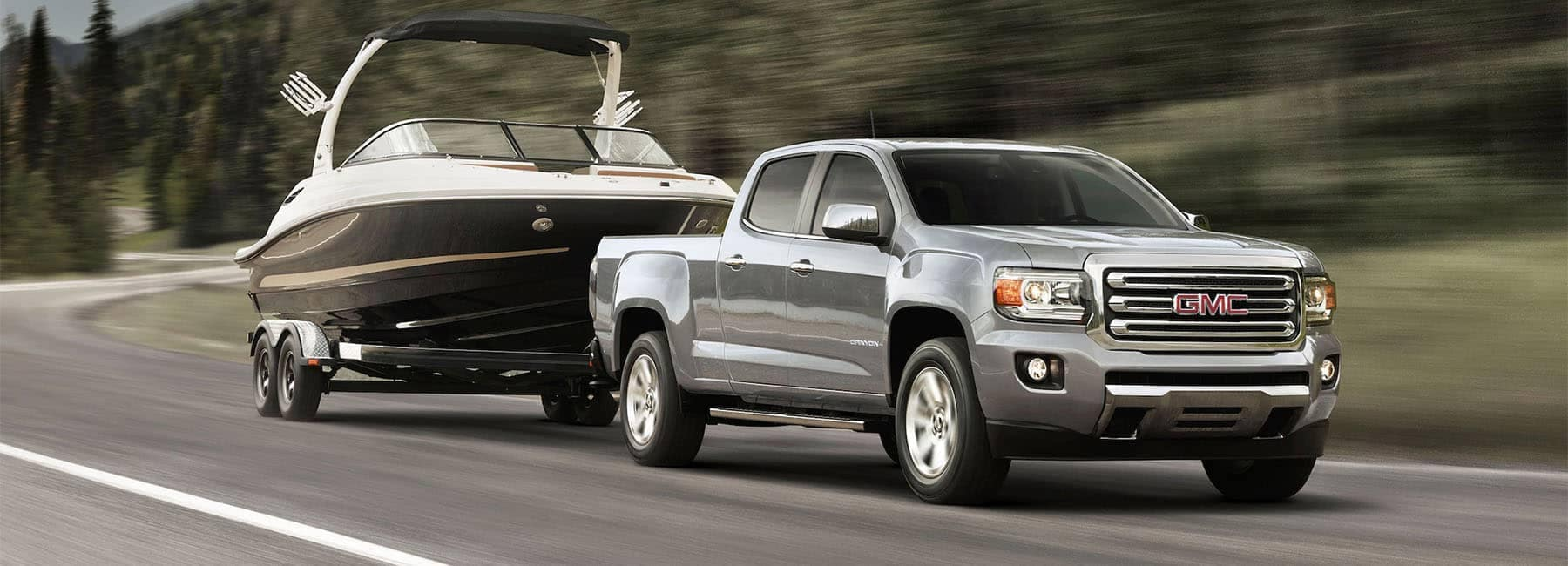 2020 GMC Canyon Small Pickup Truck External Gallery Image Towing Boat