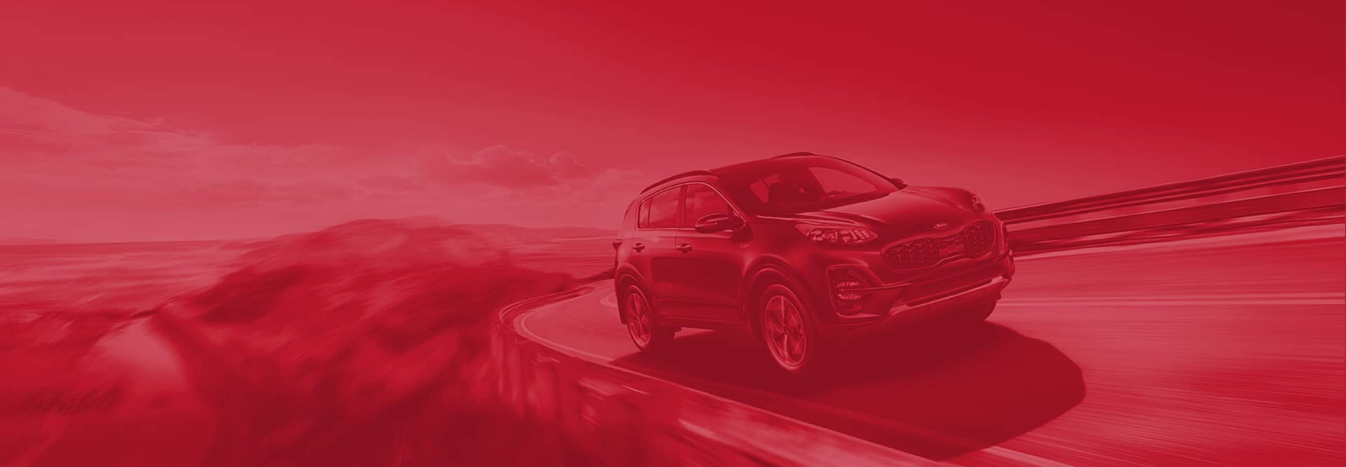 kia driving down mountain road with red overlay on whole image