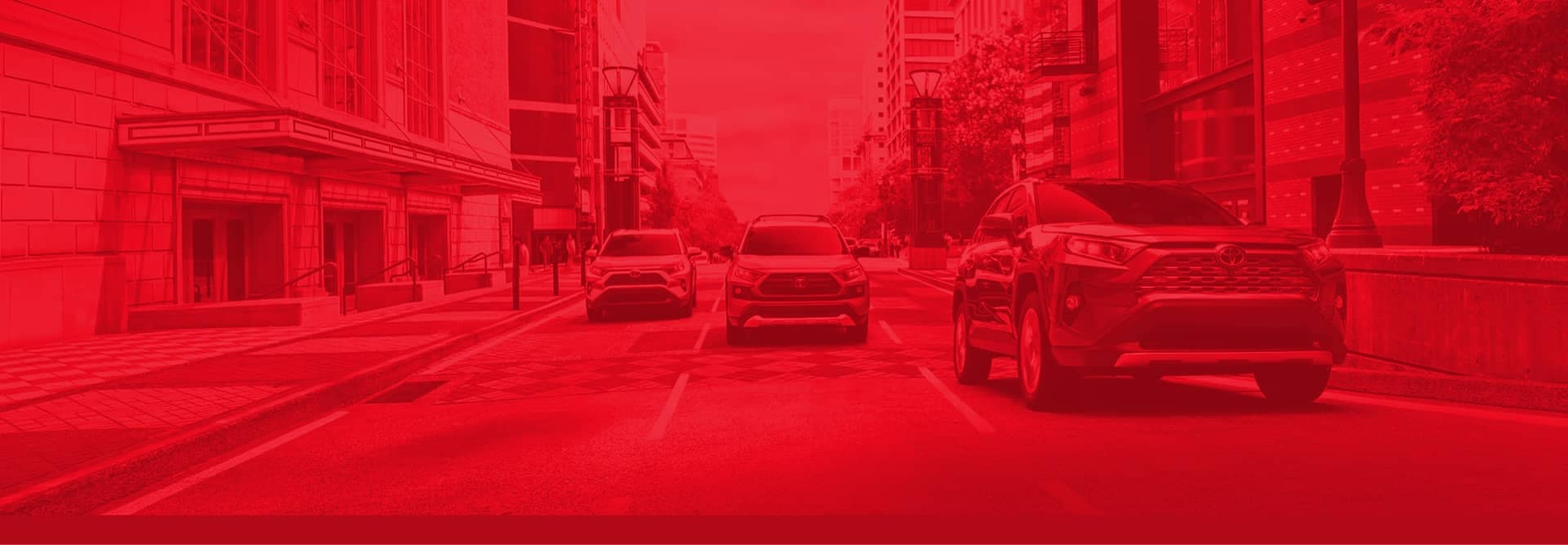 3 toyota suvs in 3 separate lanes driving through city with red color overlaying image