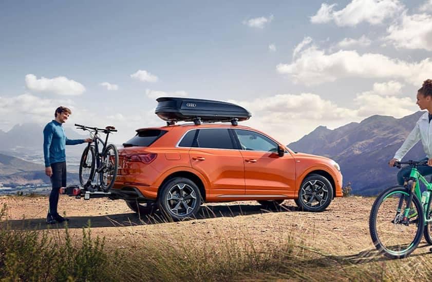 Orange Audi with bikers