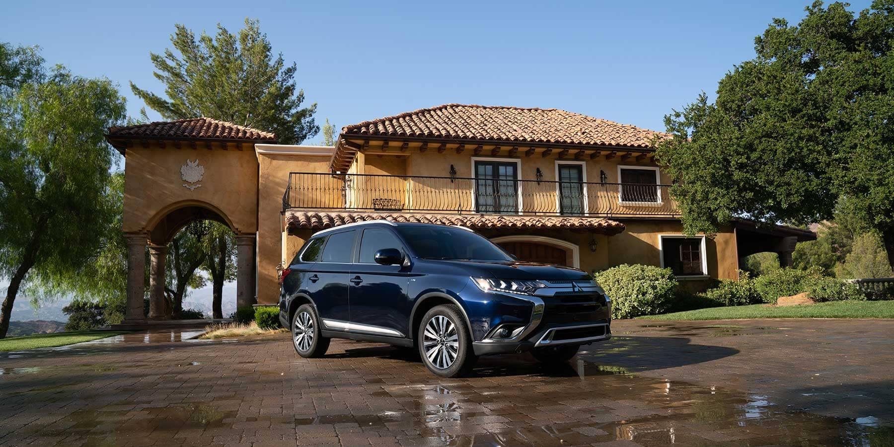 2019-Mitsubishi-Outlander parked in front of home with tiled rooftop