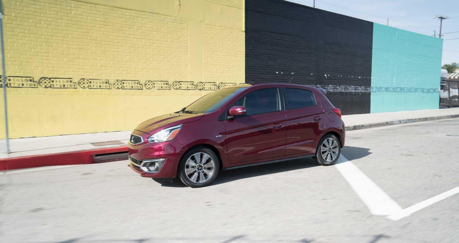 2019-mitsubishi-mirage parked in front of building with multi colored walls