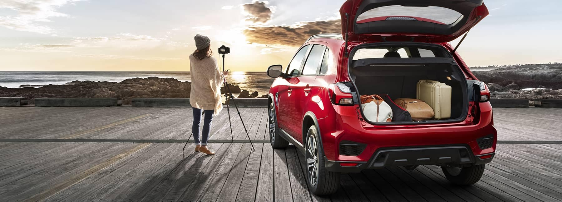 2020 Mitsubishi Outlander Sport parked at beach with woman taking photographs