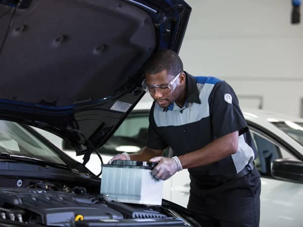 Volkswagen Service image - Service Technician replacing a car battery
