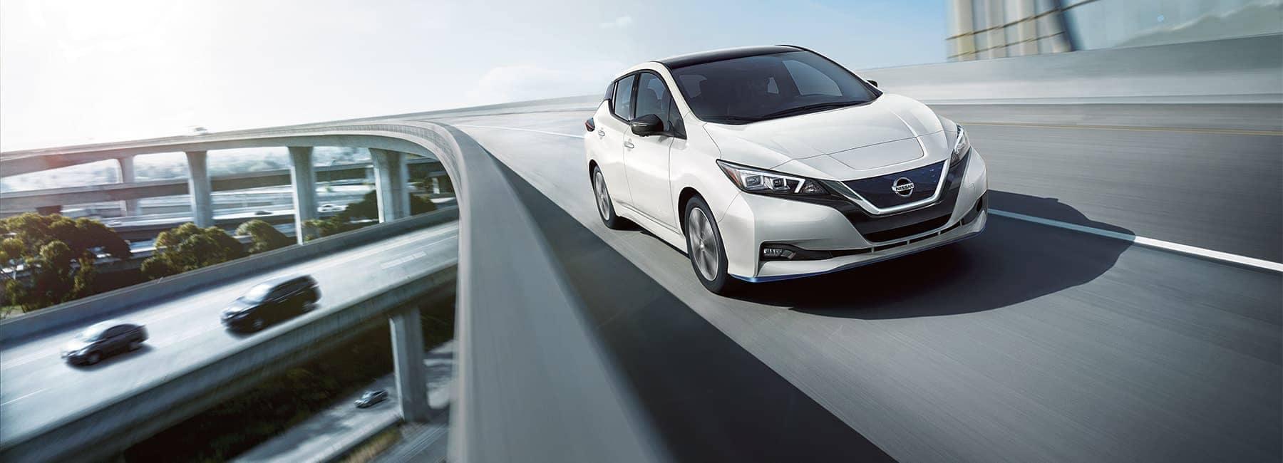 2020-nissan-leaf-exterior-driving-on-a-bridge