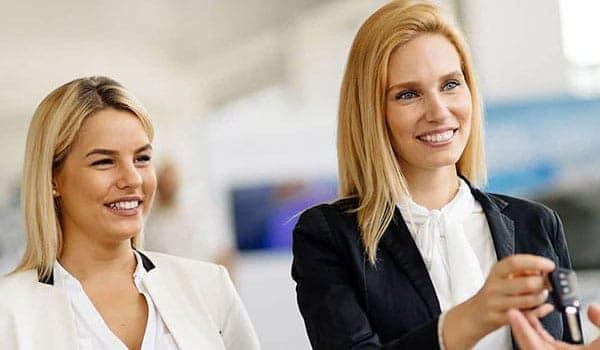 Sales women handing over the keys