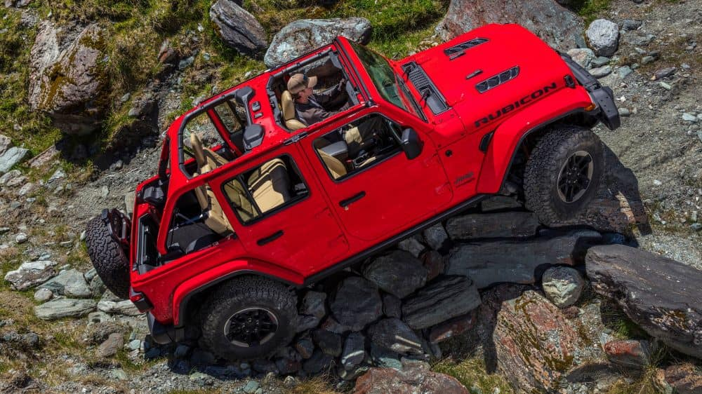 A red 2018 Jeep Wrangler Rubicon going offroading