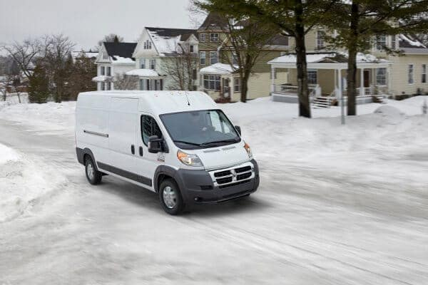 A white ProMaster in the snow