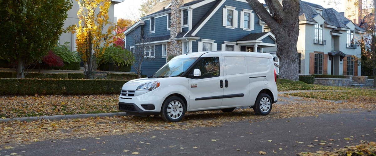 A white 2019 Ram ProMaster City parked in a suburban neighborhood