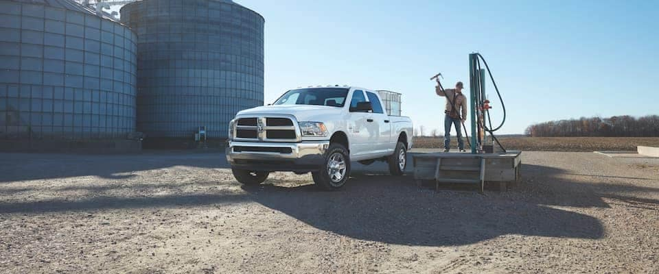 A white 2018 Ram 2500 parked on a farm