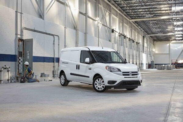 A white Ram ProMaster City parked in a warehouse