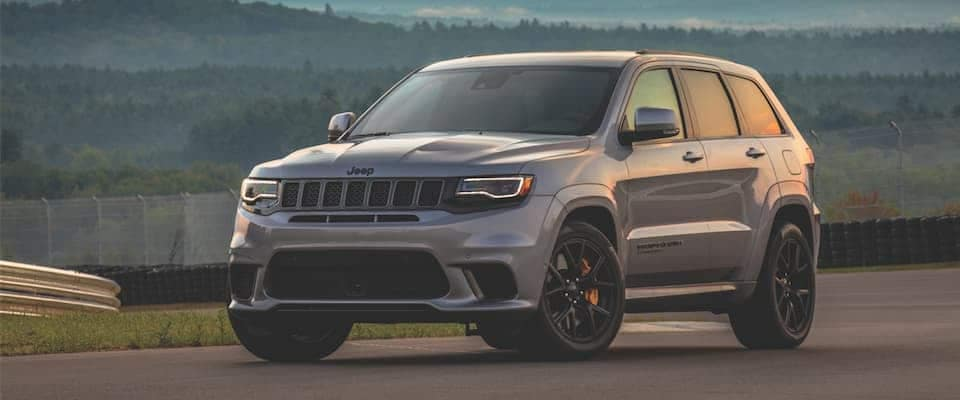 A silver Jeep Grand Cherokee parked on a track