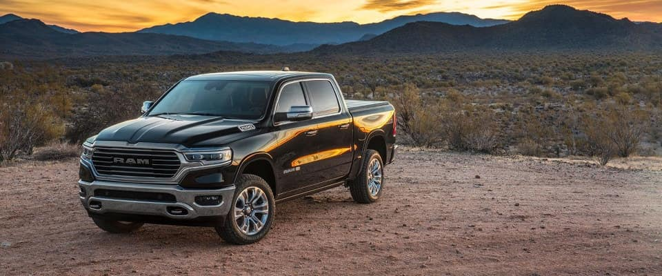 A black 2019 Ram 1500 parked at sunset