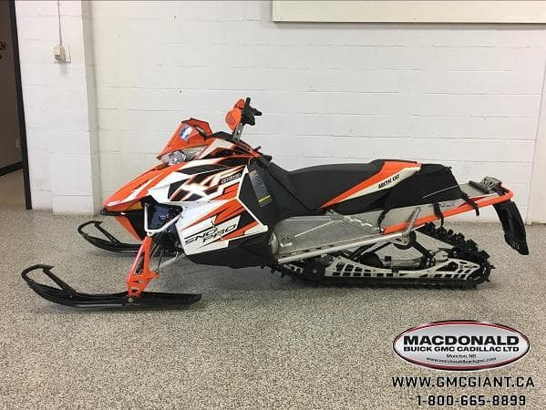 macdonald powersports image - orange snow mobile