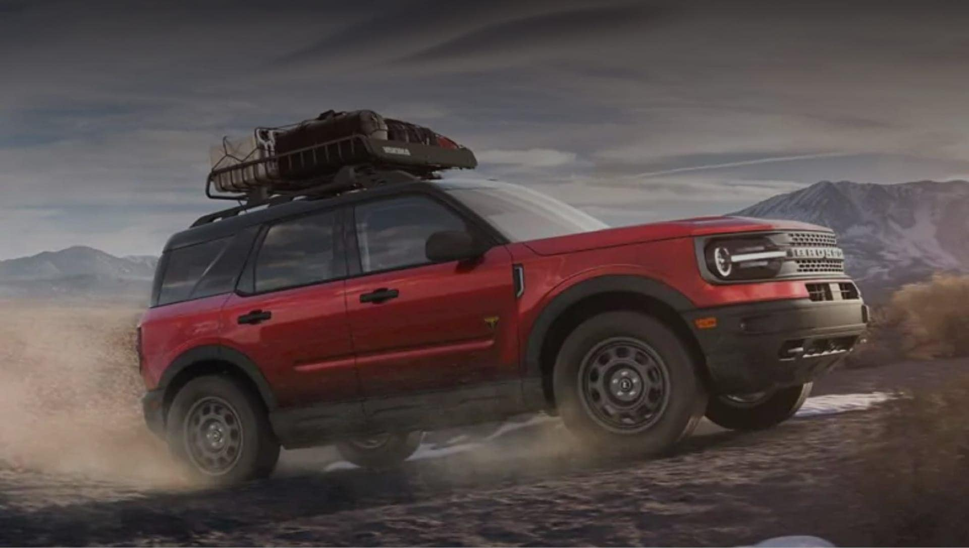 Red Ford Explorer Driving Up Mountain