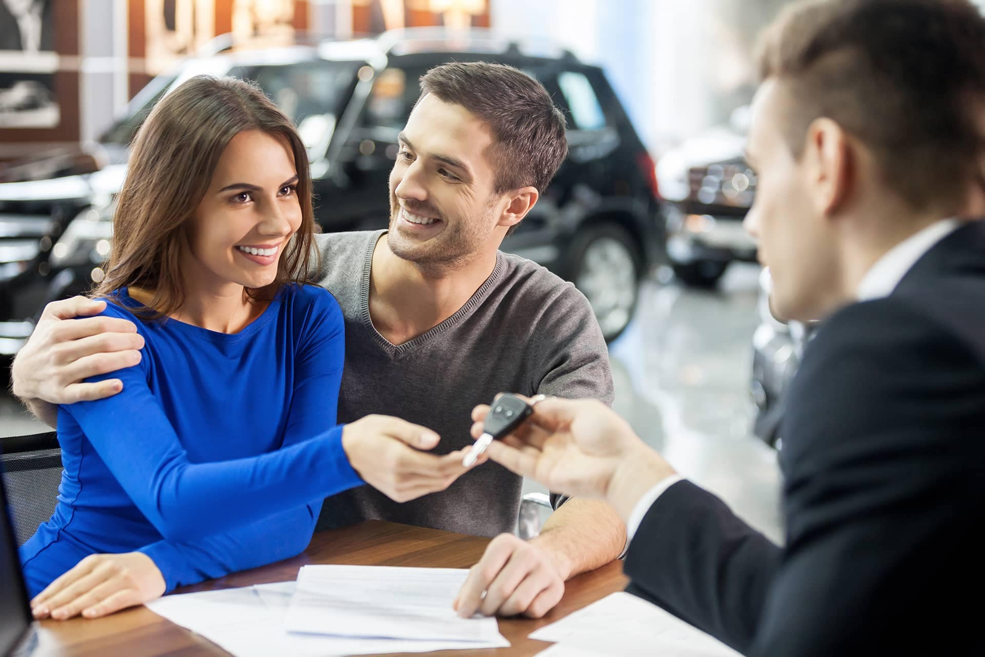 Salesman Handing Couple Keys