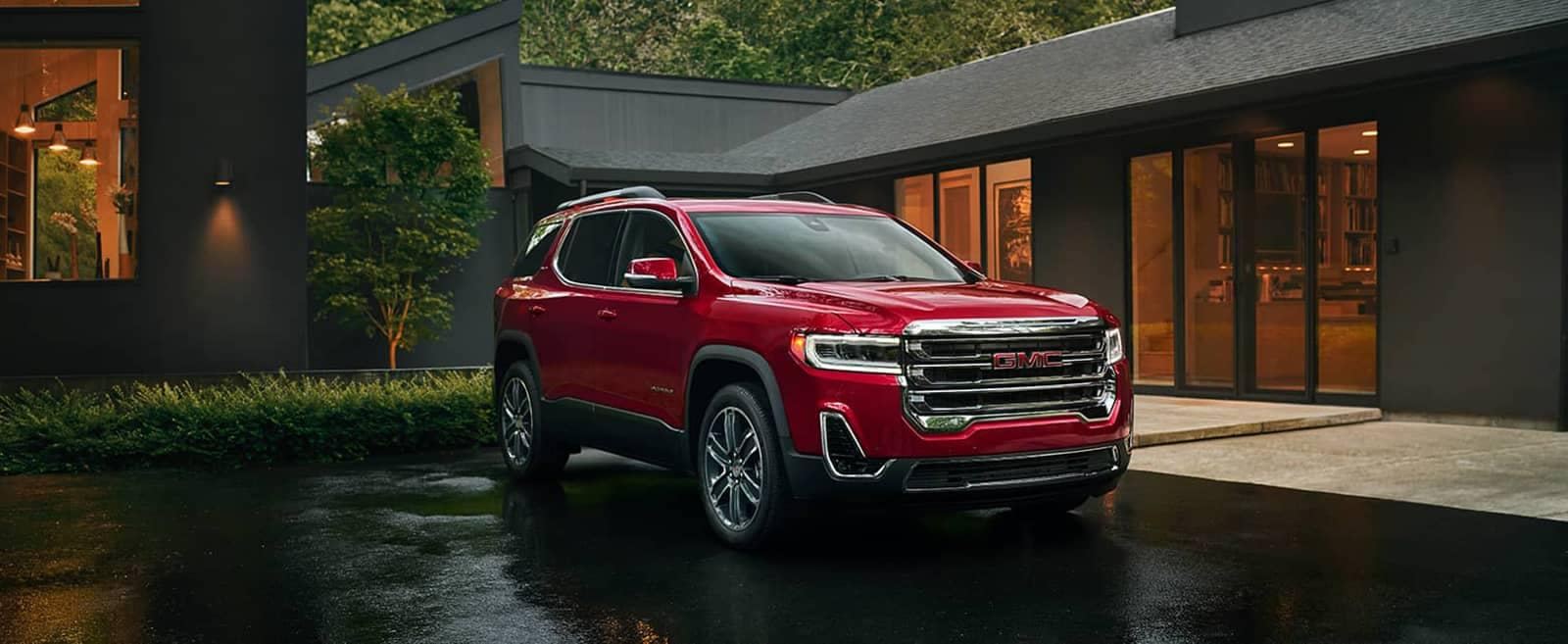 Red 2020 GMC Acadia Parked in front of a House