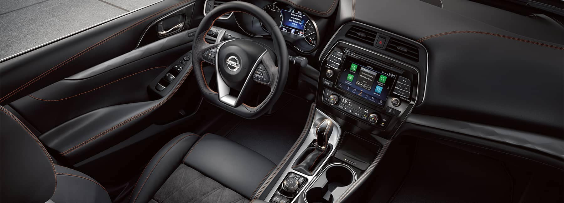 The black leather driver's seat and dashboard of a 2021 Nissan Maxima