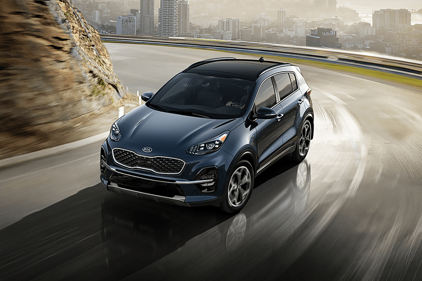 Kia Sportage on hilly highway