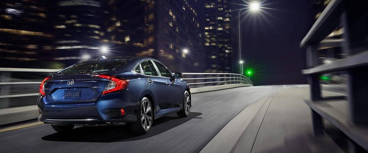 civic-sedan-drives up highway ramp