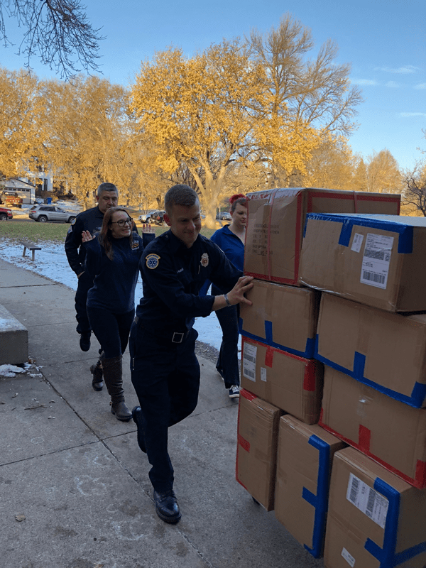 Firepeople delivering packages
