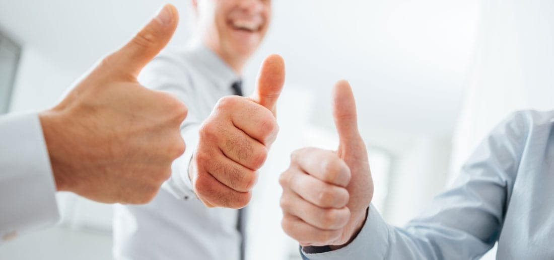People holding their thumbs up