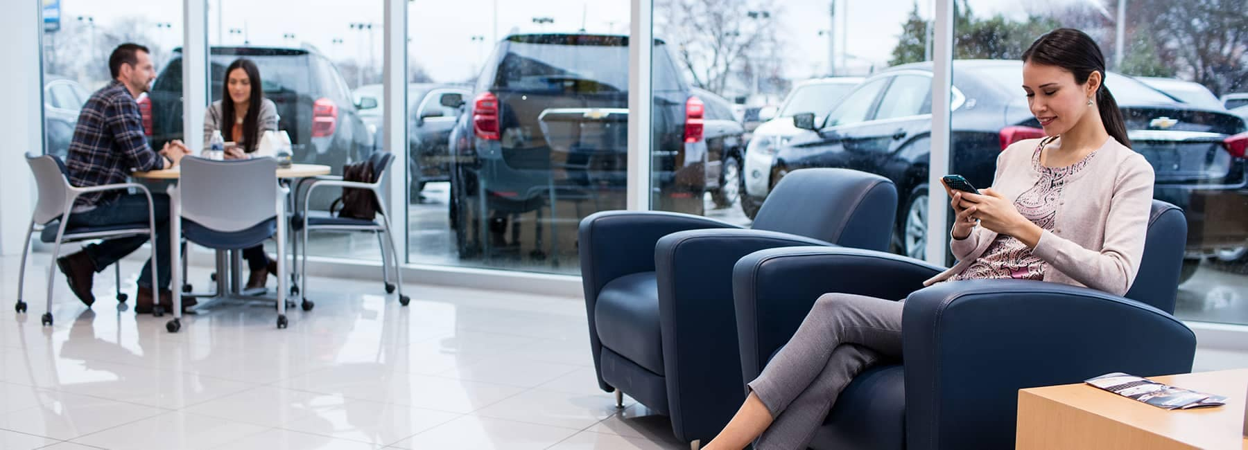 Chevrolet customers sitting in a showroom