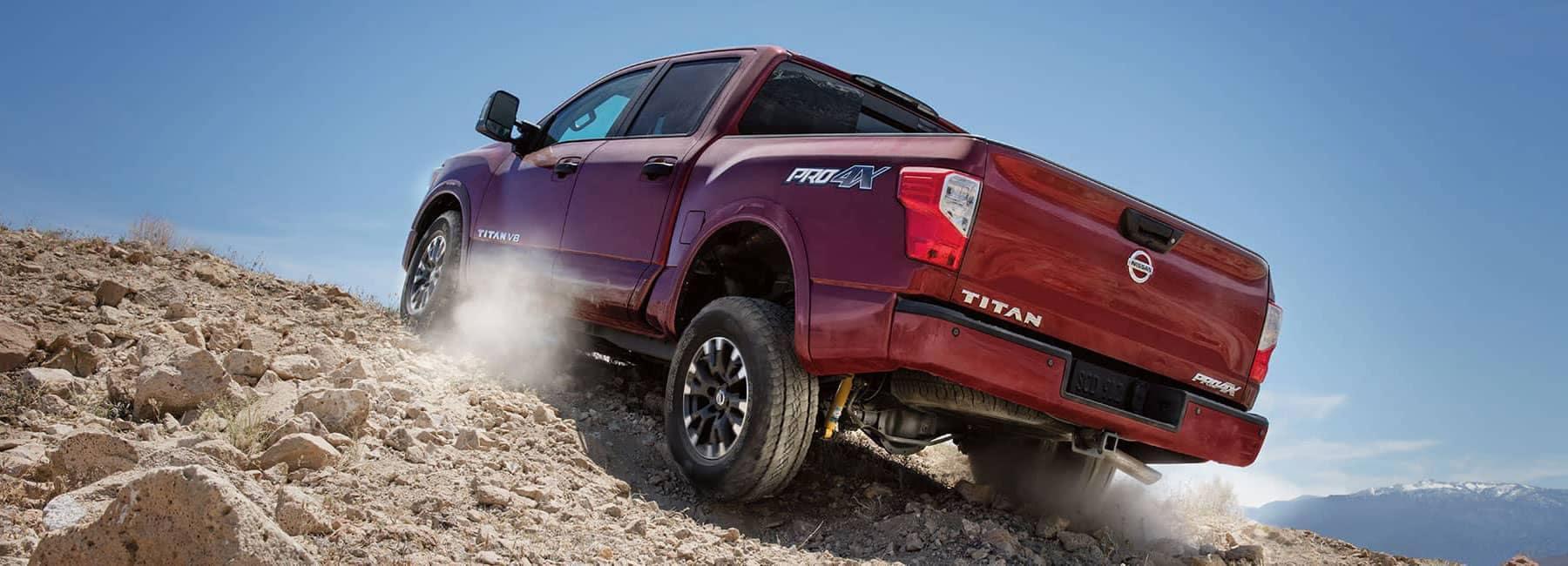 2019 Nissan Titan driving up sand hill