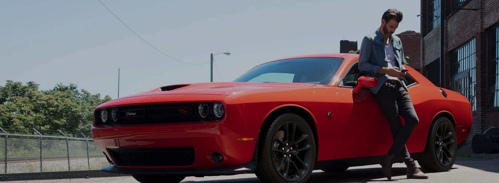 Red Dodge Challenger in Lot