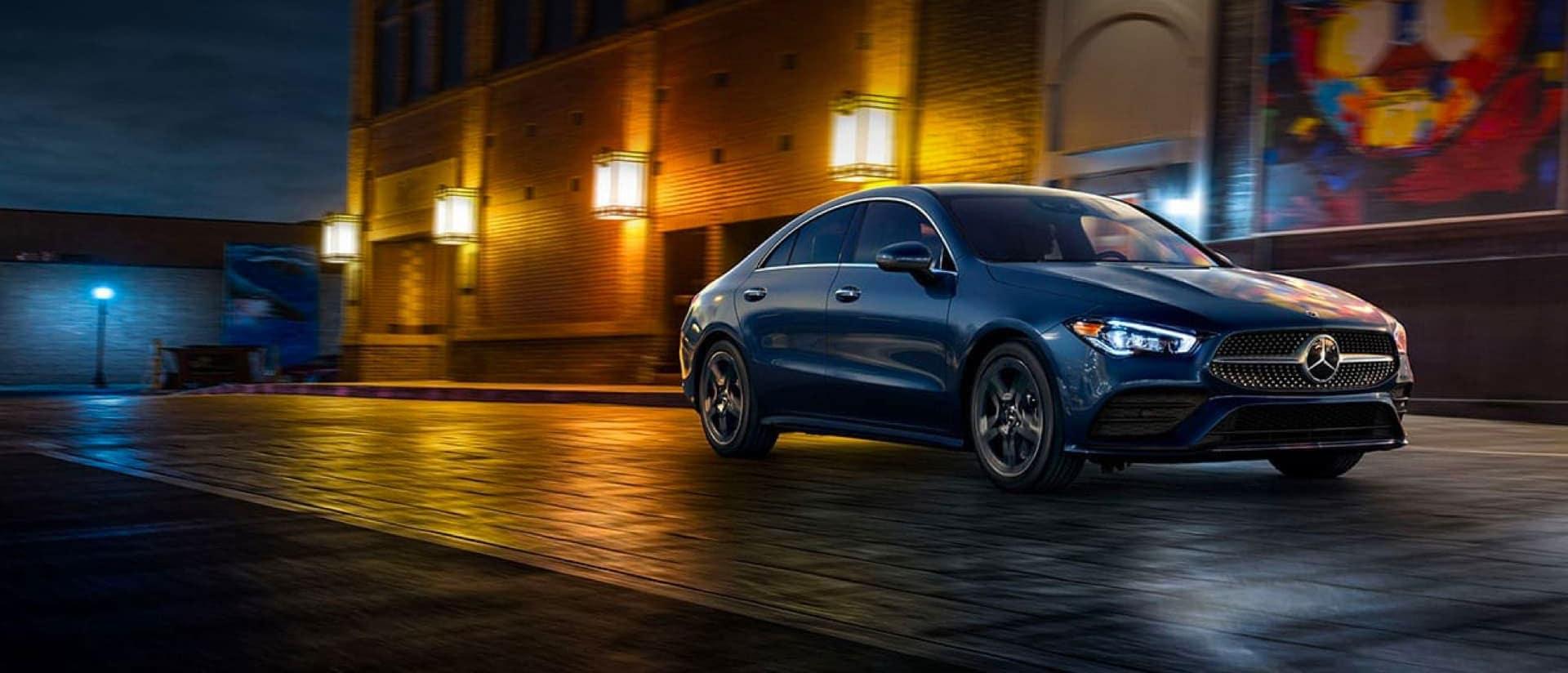 Mercedes-Benz sedan driving in the night