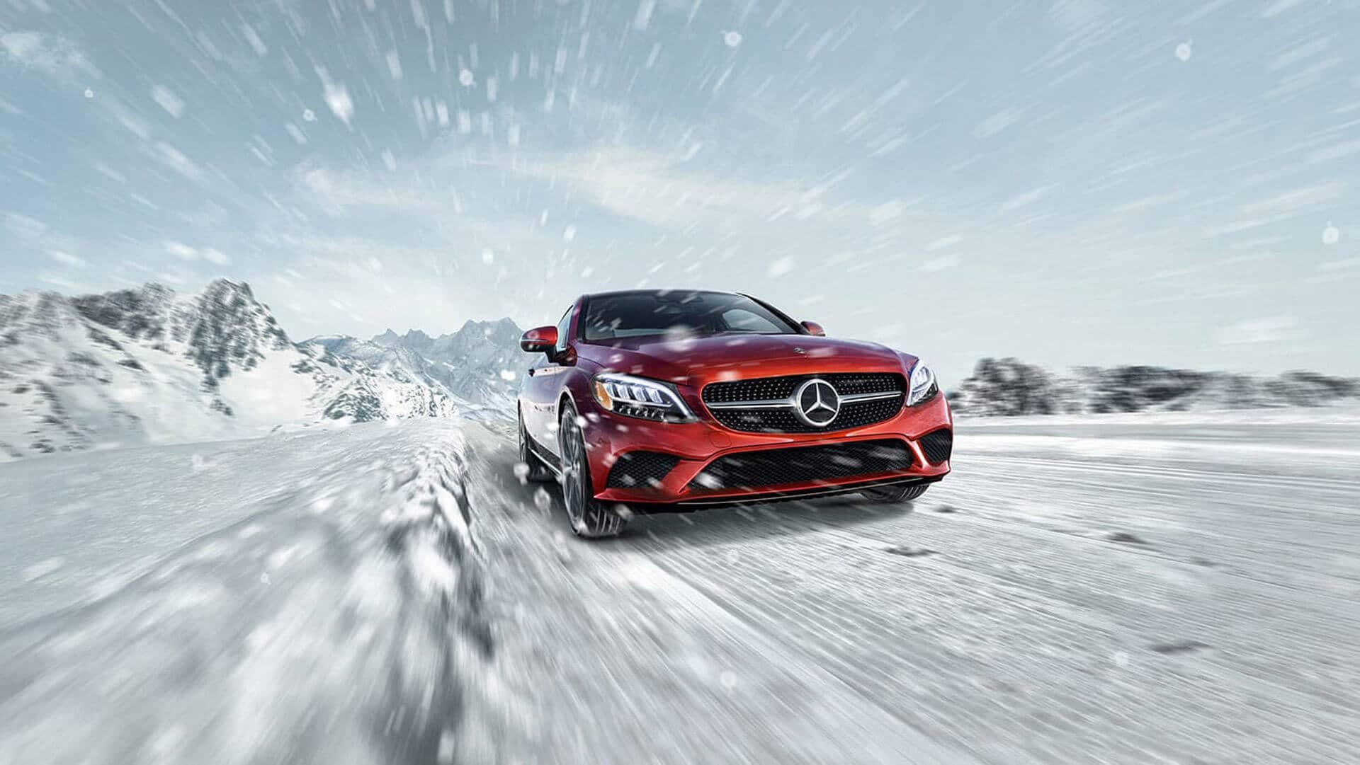 mercedes-benz C 300 4matic coupe driving in the snow