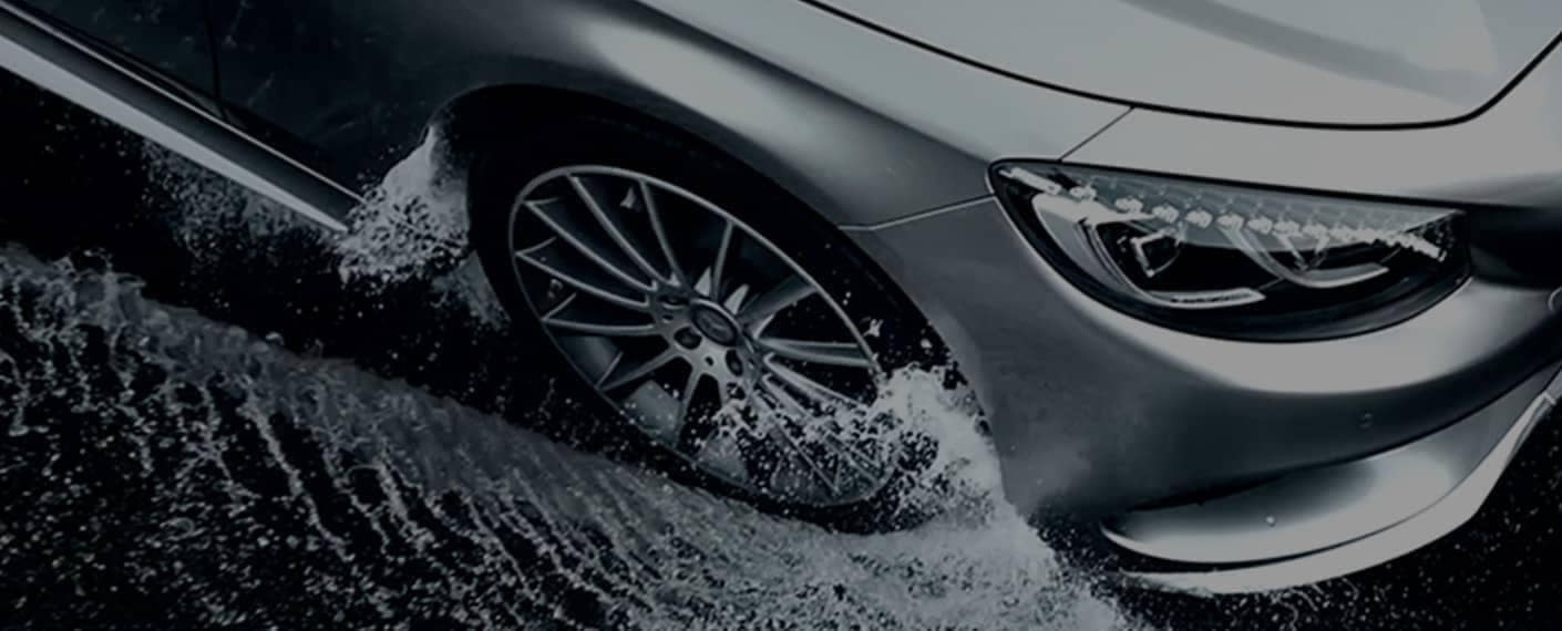 MB tire drives through wet puddles