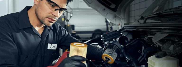 technician works on mercedes-benz vans